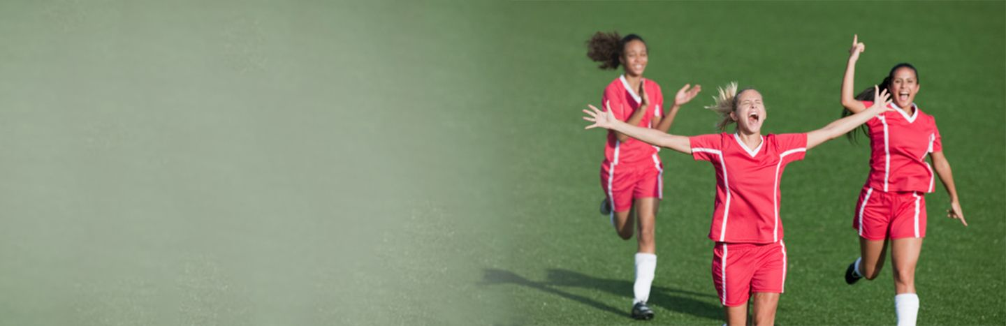 women playing soccer-feature image